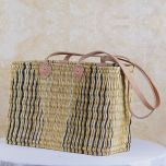 Wicker basket with long leather handles