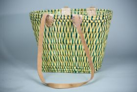Conical wicker basket with lang leather handles